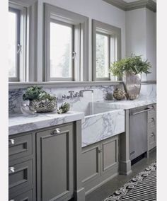 love the marble counters and sink. would probably rather white cupboards rather than gray. add color through the wall color or window treatments.
