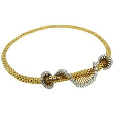 Cartier Retro Diamond Swirl  Yellow Gold Necklace. Feminine and chic Retro necklace created by Cartier in the 1940's in Paris. Sparkling diamonds swirl is twisted around a flexible 1/4 thick rounded yellow gold chain.