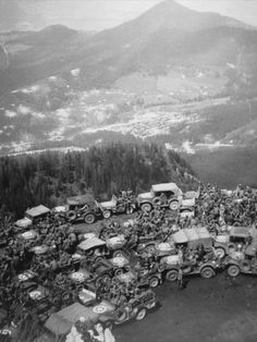 US soldiers, command cars and other various vehicles including weapons carriers gathered at the parking area of Hitler's Eagle's Nest; Berchtesgaden, Germany - June 1945