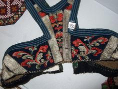 woman's bodice back. Detail from old Norwegian national costumes.  The collection of Rikard Berge and from the exebition at Seljord of old costumes from Telemark county, Norway