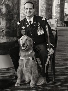 """U.S. Army Capt. Luis Montalván and his Service Dog, """"Tuesday,"""" sit for a moment at the 2013 AKC/Eukanuba National Championship. (Copyright © 2013 - 2014 
