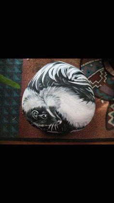 Painted skunk rock by Kristinsart4u on Etsy, $20.00