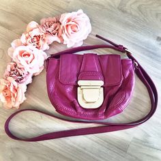 ✨HP✨ Michael Kors Fuchsia Crossbody Michael Kors Crossbody in fuchsia. It's in really good condition. Only wore once and the buckle got scratched from the move but other than that everything it's clean and like brand new. My price is firm. No trades. Michael Kors Bags Crossbody Bags