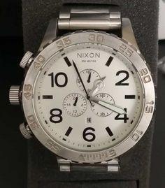 Relógio Nixon & Chrono & Prata c/ Fundo Branco & Réplica Premium AAA+ Rolex Watches, Accessories, Woman Watches, Crystals Minerals, Silver, Luxury, Ornament