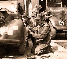 During the second world war Princess Elizabeth served with the Number 1 'Beaufront' Company, Auxiliary Territorial Service as a driver, she is seen here changing the tyre on a Tilly light truck and with an Austin K2 Ambulance