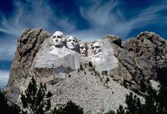"""Colossal granite heads of Presidents George Washington, Thomas Jefferson, Theodore Roosevelt, and Abraham Lincoln are not eroding """"since the estimated erosion rate is 1 inch every 10,000 years."""" Photo #34 by National Park Service Digital Image Archives"""