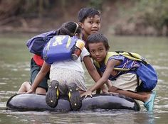 Kids getting to school across the world: Elementary School Students Crossing A River On Inflated Tire Tubes, Rizal Province, Philippines Schools Around The World, Kids Around The World, We Are The World, People Of The World, Around The Worlds, Walk To School, Public School, High School, Fotojournalismus