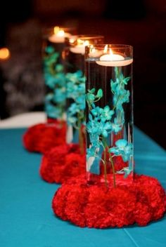 """Red and blue centerpieces  Wood """"coaster"""" instead of red flowers"""