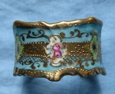 antique Hand Painted PORCELAIN NAPKIN RING Pretty Blue Background w Roses & Gold