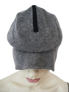 Designer: MolaMust    Item: Beret    Composition: 100% Merinos Wool    Made in Italy    Description:    Beret with inset         Beret Molamust in ecofriendly wool yarn, ample style inset of black ribbon in the centre      > Need Help?    Price $ 164.00 $82.00    Discount: -50%