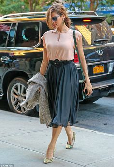 Pretty in pink: Eva Mendes, 39, wore floaty fall fashion on the way to a meeting in New York on Tuesday
