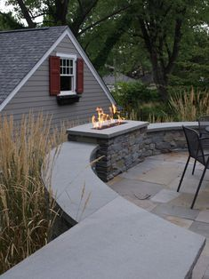 Fire pit integrated into wall
