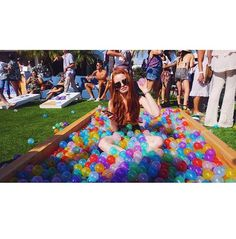 How can someone look so good just sitting in a pool of colorful balls