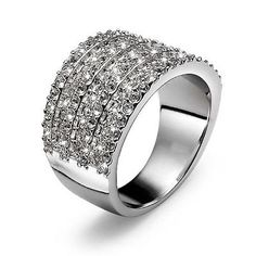 Stunning Ring made of rhodium plated metal. Seven rows of Sparkling Swarovski Crystals make up this eye catching piece.