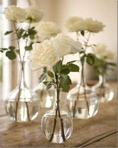 Pinning for the glass bud vases *original pin text: simple - white roses in glass vases Wedding Centerpieces, Wedding Table, Wedding Decorations, White Rose Centerpieces, Simple Table Decorations, Small Centerpieces, Stage Decorations, Centrepieces, Bud Vases