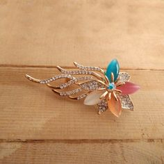 Beautiful Colored Stones Brooch in beautiful floral pattern.  Wear it on your western or indian dress to look beautiful. #indiangoldess #newarrivals #brooches #festivefeel
