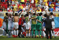 Costa Rica players celebrate after the 2014 World Cup Group D soccer match between Italy and Costa Rica at the Pernambuco arena in Recife June 20, 2014.
