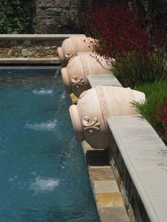 This is a water feature that spills into a Mediterranean Pool.