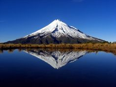 Mount Taranaki, (also known as Mount Egmont), New Plymouth, The North Island, New Zealand (The Hobbit Lonely Mountain Film Location) New Zealand North, New Zealand Travel, Beautiful Places To Visit, Beautiful World, The Places Youll Go, Places To See, Mountain Love, Monte Fuji, Foto Blog