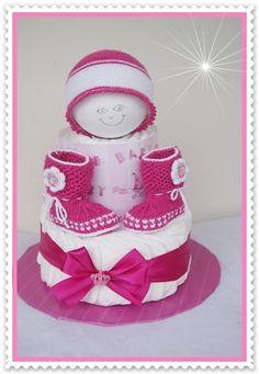 Windeltorte mit Baby Stiefel pink Windeltorte von Geschenke-Eckle auf DaWanda.com