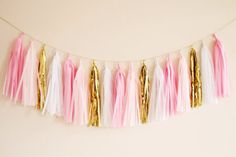 Our soft and pretty pinks, blush, white and gold tassel garland adds the perfect amount of glitz and glam to your decor!    We see this tassel