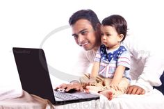 Indian father and son looking at laptop