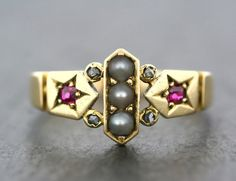 A stylish piece of Victorian jewellery. Typical of a style of 19cth century ring, this 18ct gold ring uses rubies, natural pearls and diamonds $892