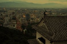 Matsuyamajo castle in the dusk coupling with lively city lights of Matsuyama city