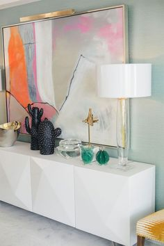 How To Style a Credenza: See Kelly Golightly's Colorful Palm Springs Dining Room designed by Christopher Kennedy for ideas. How To Style a Credenza: See Kelly Golightly's Colorful Palm Springs Dining Room designed by Christopher Kennedy for ideas. Home Design, Home Interior Design, Interior Decorating, Palm Springs Interior Design, Room Interior, Decorating Games, Dining Room Colors, Dining Room Design, Dining Room Art