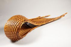 Sculpture suggestive of a great, rolling wave. Woven of stained, split and branch bamboo with stained rattan. Signed with an incised signature by the artist on the reverse: Hideaki (Honma Hideaki, born 1959). Heisei 23 or 2011. With the tomobako or original box, titled on the reverse of the lid: Fu Mon no Nami or Wind Patterned Waves, and signed: Hideaki, and sealed: Hideaki. This piece was made for exhibition at the Nitten in 2011. For another example of his work, c.f. Masanori Moroyama's…