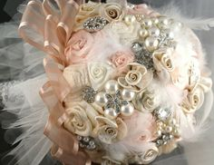 BOUQUET STYLE: Taupe, cream and silver broach bouquet with silk ribbon roses, feathers, and pearls