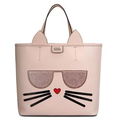 Karl Lagerfeld's pet cat Choupette inspired this playful shopper. Adorned with whiskers and a heart-shaped nose, the bag is finished with glitter detail sunglasses.