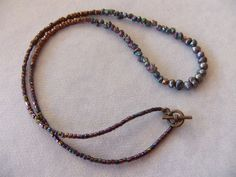 Freshwater Pearl, Titanium Pyrite Nugget, Copper, and Iridescent Seed Bead Rustic Necklace by centerofbalance on Etsy
