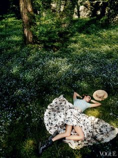 Soak Up the Scenery - Our model steals away to the flower-dotted estate of Schloss Damtschach, a 16th-century Renaissance castle across the lake from the clinic. Rochas cashmere polo and floral-print silk skirt. Céline hat. Marni boots.