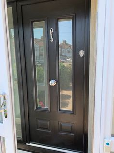 Schwarzbrun Black Ludlow Solidor Composite Door by Wright Glazing Oak Front Door, Front Door Porch, Black Front Doors, Front Doors With Windows, House Front Door, Painted Front Doors, Front Door Design, Glass Front Door, House With Porch