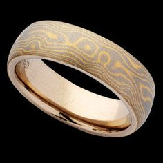 The main advantage of titanium wedding rings is that they come in a large variety of colors, and with or without precious stones, they have an impressive, unique design. Description from theweddingspecialists.net. I searched for this on bing.com/images