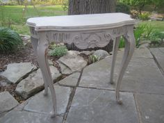 "Antique, petite console table, painted in ""French linen""."