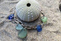 Look Ma!  I made this and love the awesome drilling and the few charms instead of packing them in!Beach Glass Charm Bracelet Sea Glass Charm Bracelet by timeremains,