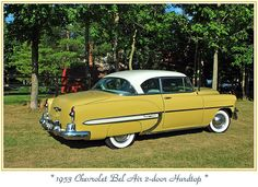 1953 mustard yellow Chevrolet Bel Air.  Mom's and Dad's car when I was a little kid.