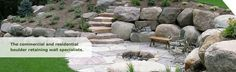 Boulder Retaining Walls with fire pit Fire Pit Landscaping, Garden Landscaping, Boulder Retaining Wall, Retaining Walls, Bouldering, The Great Outdoors, Home Projects, Stepping Stones, Stairs