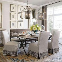 Casual chairs in linen slipcovers gather around a table made of reclaimed barn wood in this light and lovely showhouse dining room. - Traditional Home ®/ Photo: Werner Straube / Design: Crysta Allsbrooks Parish