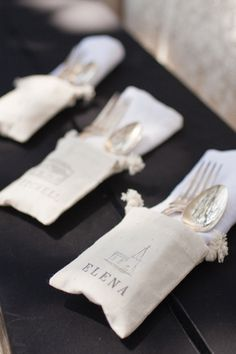 Custom silverware pockets - use stamps to add guests names to canvas or linen bags with drawstrings ... then add napkins and cutlery!