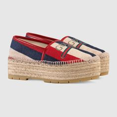 Shop the Gucci logo Sylvie platform espadrille by Gucci. Originally influenced by the flowing dresses of Indian dancers, the baiadera fabric is brought back from the House's archives and reinterpreted with the Sylive Web colors of white, blue and red. Embodying the marine feel explored throughout the collection, the striped linen canvas is displayed on the platform espadrille and paired with the 80s-inspired Gucci vintage logo.