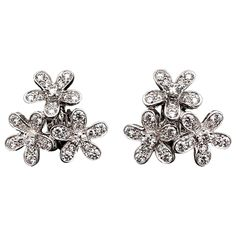 Van Cleef & Arpels Diamond Gold Flower Earrings | From a unique collection of vintage more earrings at https://www.1stdibs.com/jewelry/earrings/more-earrings/