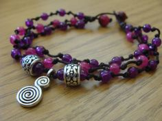 Simply knots Beaded multi strand Bracelet, purple & fuchsia glass beads, Spiral Calabash Charms, hippie boho gypsy charm bracelet, for her on Etsy