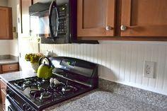 Beadboard backsplash in a kitchen...beautiful!
