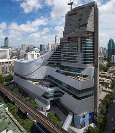 designed by AL_A, the bangkok central embassy has reached full height, and in may 2014 opened its doors to the retail-programmed areas on its lower floors. Architecture Antique, Architecture Panel, Futuristic Architecture, Contemporary Architecture, Amazing Architecture, Interior Architecture, Tower Building, Building Facade, Building Design