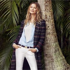 Modeling outdoors, Behati Prinsloo poses in a striped coat from Tommy Hilfiger spring 2016 lookbook