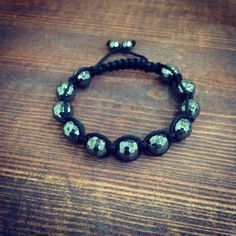 Shamballa Bracelet - featuring a nice black semi glossy cord, black hematite beads with a faceted crystals embellishment all set to an adjustable length and a secured knot fastening. Designer quality!  Suitable for keeping for self and sending as a gift. Fabric Alloy. Limit contact with liquids and perfumes to maintain integrity of wrist piece.The look is trendy but with a vintage feel. All of our designs are unique, one of a kind, hand made fashion-treasures. #Www.CharmedByJustice.com