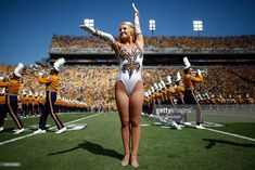 A member of the Golden Girls of Louisiana State University Tigers cheers before…